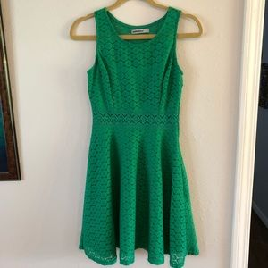 Cute green lace mini dress, fitted at waist